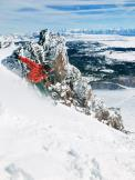 a man riding a wave on top of a snow covered slope,outdoor,snow,skiing,mountain,ice,nature,snowboarding,glacier,ski,glacial landform,wave,slope